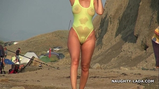 Transparent swimsuit and naked on the beach